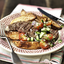 Char-grilled steak with crispy potato wedges